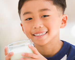 School Boy Drinking Milk